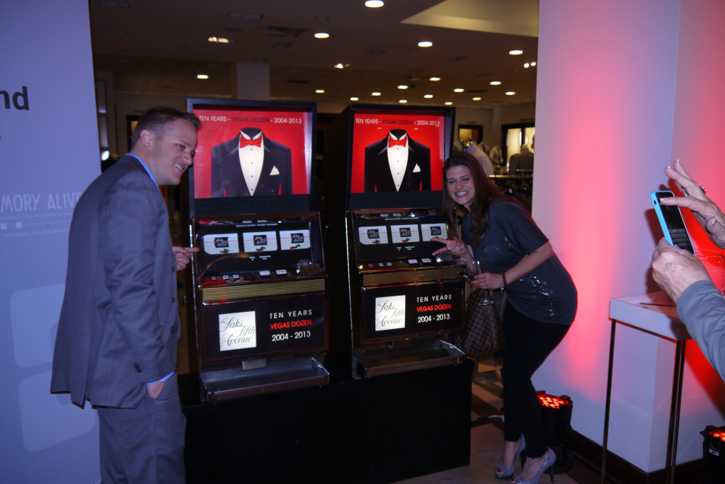 "Guests enjoy the ""Vegas Dozen"" Promo Slot at Saks 5th ave at the fashion show mall in Las Vegas, NV"